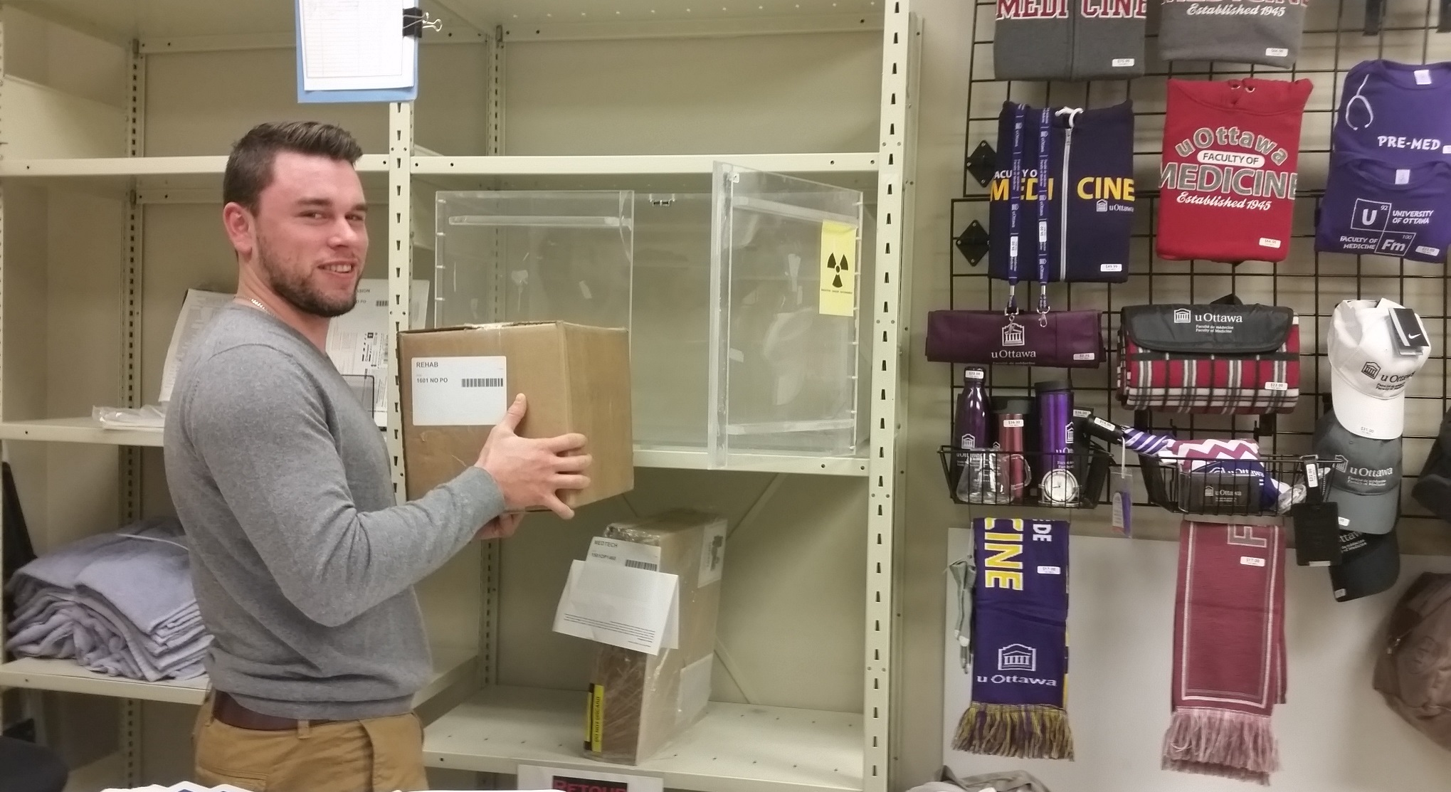 Thierry Gibeault from MedPurch placing a radioisotope package in shielded storage box.